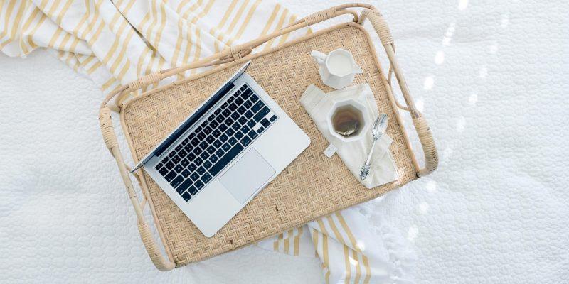 Laptop on a wicker tray